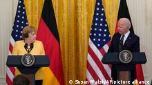 President Joe Biden and German Chancellor Angela Merkel speak during a news conference in the East Room of the White House in Washington, Thursday, July 15. (AP Photo/Susan Walsh)