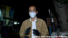 Indonesia President Joko Widodo (Jokowi) took to the streets at night to deliver basic needs and medicine packages for families in Jakarta, Thursday (15/07/21). Credit: Biro Pers Sekretariat Presiden image can be used for article and social media.