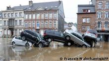 15.07.2021 A picture taken on July 15, 2021 shows cars piled up by the water at a roundabout in the Belgian city of Verviers, after heavy rains and floods lashed western Europe, killing at least two people in Belgium. (Photo by François WALSCHAERTS / AFP)