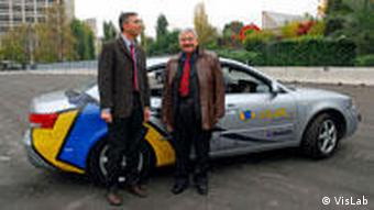 Alberto Broggi (left) expects the vehicle to arrive on schedule on October 28 in Shanghai
