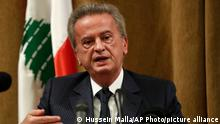 """Riad Salameh, the governor of Lebanon's Central Bank, speaks during a press conference, in Beirut, Lebanon, Nov. 11, 2019. On Monday, Jan. 25, 2021, Lebanon's foreign minister held talks Monday, Jan 25, 2021, with the Swiss ambassador to Beirut after Switzerland started a probe into possible money laundering and embezzlement at the Mideast country's central bank. On Monday, the governor issued a statement saying reports about large transfers """"are very exaggerated and have nothing to do with reality."""" (AP Photo/Hussein Malla)"""