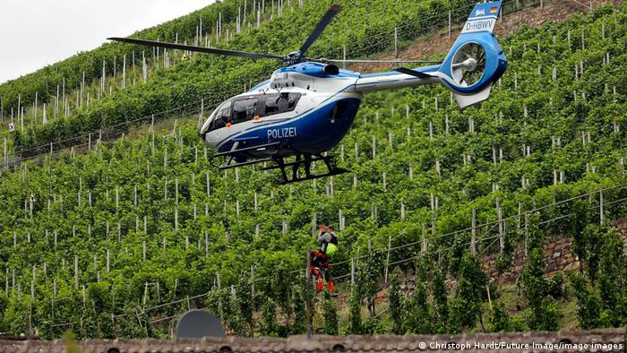 A helicopter lands in the vineyards