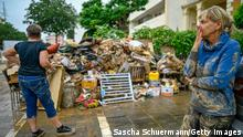 BAD NEUENAHR, GERMANY - JULY 16: Resident Elke Wissmann stands in front of her property that was destroyed by the flood on July 16, 2021 in Bad Neuenahr - Ahrweiler, Germany. (Photo by Sascha Schuermann/Getty Images)