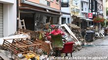 Bad Neuenahr-Ahrweiler, 16/07/2021*** A local resident cleans up debris in a street in Bad Neuenahr-Ahrweiler, western Germany, on July 16, 2021, after heavy rain hit parts of the country, causing widespread flooding and major damage. - The death toll from devastating floods in Europe soared to at least 126 on July 16, most in western Germany where emergency responders were frantically searching for missing people. (Photo by CHRISTOF STACHE / AFP) (Photo by CHRISTOF STACHE/AFP via Getty Images)