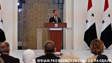 A handout picture released by the official Facebook page of the Syrian Presidency shows President Bashar al-Assad delivering a speech at the swearing-in ceremony for his fourth term, in the capital Damascus, on July 17, 2021. - Al-Assad took the oath of office for a fourth term in war-ravaged Syria, after taking 95 percent of the vote in a controversial election dismissed abroad. (Photo by - / SYRIAN PRESIDENCY FACEBOOK PAGE / AFP) / RESTRICTED TO EDITORIAL USE - MANDATORY CREDIT AFP PHOTO / SYRIAN PRESIDENCY FACEBOOK PAGE - NO MARKETING NO ADVERTISING CAMPAIGNS - DISTRIBUTED AS A SERVICE TO CLIENTS