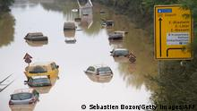 TOPSHOT - Submerged cars and other vehicles are seen on the federal highway B265 in Erftstadt, western Germany, on July 17, 2021, after heavy rains hit parts of the country, causing widespread flooding and major damage. - Rescue workers scrambled on July 17 to find survivors and victims of the devastation wreaked by the worst floods to hit western Europe in living memory, which have already left more than 150 people dead and dozens more missing. (Photo by SEBASTIEN BOZON / AFP) (Photo by SEBASTIEN BOZON/AFP via Getty Images)