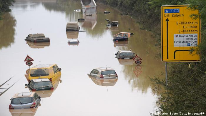 Cars float on a flooded highway