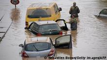 Soldiers of the German armed forces Bundeswehr search for flood victims in submerged vehicles on the federal highway B265 in Erftstadt, western Germany, on July 17, 2021, after heavy rains hit parts of the country, causing widespread flooding and major damage. - Rescue workers scrambled on July 17 to find survivors and victims of the devastation wreaked by the worst floods to hit western Europe in living memory, which have already left more than 150 people dead and dozens more missing. (Photo by SEBASTIEN BOZON / AFP) (Photo by SEBASTIEN BOZON/AFP via Getty Images)