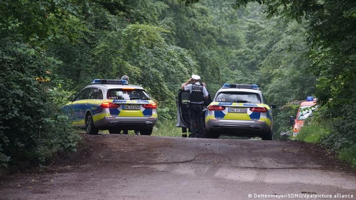 Police cars and police officers at the crash site