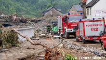 Altenahr, 17.7.2021*** Members of the fire brigade help during clearing work in Altenahr, western Germany, after heavy rain hit parts of the country, causing widespread flooding and major damage. - Rescue workers scrambled on July 17 to find survivors and victims of the devastation wreaked by the worst floods to hit western Europe in living memory, which have already left more than 150 people dead and dozens more missing. (Photo by Torsten SILZ / AFP)