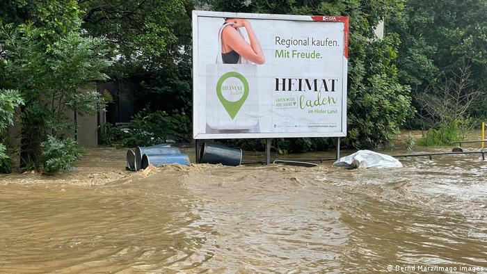 A billboard rises above floodwater in Bavaria