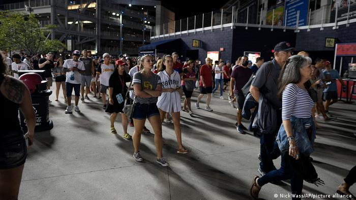 Spectators leave the stadium after an incident near the ballpark during the sixth inning of a baseball game between the Washington Nationals and the San Diego Padres