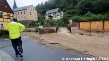 Floodwater runs down the road following heavy rainfall in Bad Schandau, Saxon Switzerland, Saxony, Germany July 17, 2021 in this still image taken from social media video filmed on July 17, 2021. Andreas Hering/via REUTERS THIS IMAGE HAS BEEN SUPPLIED BY A THIRD PARTY. MANDATORY CREDIT. NO RESALES. NO ARCHIVES.