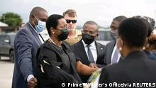 Haiti's first lady Martine Moise (L), the wife of assassinated President Jovenel Moise, is greeted by Haiti?s interim Prime Minister Claude Jospeh, after arriving from the U.S, in Port-au-Prince, Haiti, in this undated photograph obtained by Reuters on July 17, 2021. Prime Minister's Office/Handout via REUTERS ATTENTION EDITORS - THIS PICTURE WAS PROVIDED BY A THIRD PARTY. NO RESALES. NO ARCHIVES