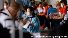 Members of the Netherlands delegation wait for screening and Covid testing upon their arrival on a flight from Amsterdam at Narita International Airport in Narita, Chiba Prefecture on July 18, 2021, ahead of the 2020 Olympic Games in Tokyo. (Photo by David GANNON / AFP) (Photo by DAVID GANNON/AFP via Getty Images)