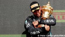 Lewis Hamilton celebrates winning the British Grand Prix