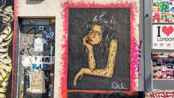 Graffiti of Amy Winehouse on a wall in Camden