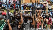 18.07.2021 Members of the new self-defence group called El Machete, that intends to combat criminal groups in the San Jose Tercero indigenous Tzotzil community, parade during their presentation in the municipality of Pantelho, Chiapas State, Mexico on July 18, 2021. (Photo by ISAAC GUZMAN / AFP) (Photo by ISAAC GUZMAN/AFP via Getty Images)