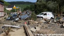Damaged cars are seen over the rail track in Heimersheim, a suburb in Bad Neuenahr-Ahrweile, Germany July 18, 2021. REUTERS/Wolfgang Rattay