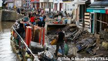 Police officers and volunteers clean rubble in an area affected by floods caused by heavy rainfalls in Bad Muenstereifel, Germany, July 18, 2021. REUTERS/Thilo Schmuelgen