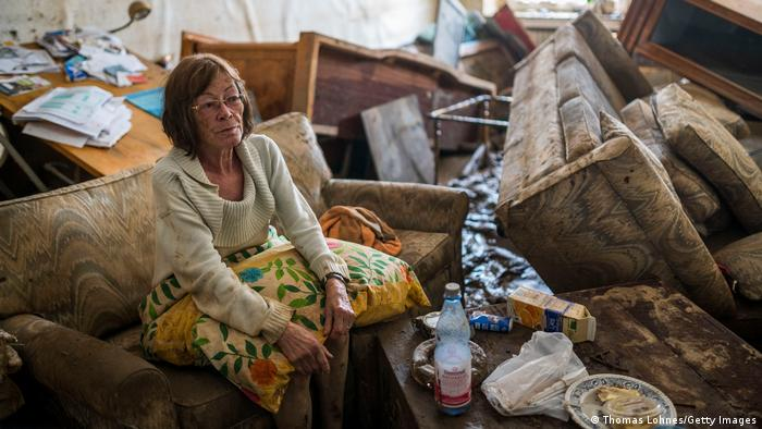 Jutta Schnelleckes sits in the living room of her apartment, which was completely destroyed by the flood in Bad Neuenahr