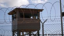 FILE PHOTO: A soldier stands guard in a tower overlooking Camp Delta at Guantanamo Bay naval base in a December 31, 2009 file photo provided by the US Navy. REUTERS/US Navy/Spc. Cody Black/Handout via Reuters THIS IMAGE HAS BEEN SUPPLIED BY A THIRD PARTY. IT IS DISTRIBUTED, EXACTLY AS RECEIVED BY REUTERS, AS A SERVICE TO CLIENTS. FOR EDITORIAL USE ONLY. NOT FOR SALE FOR MARKETING OR ADVERTISING CAMPAIGNS/File Photo/File Photo