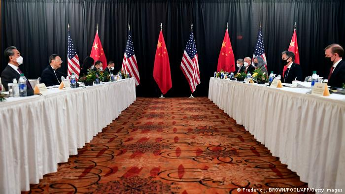 The Chinese and US delegations face off at opposing long tables in Anchorage