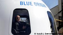 FILE PHOTO: Amazon and Blue Origin founder Jeff Bezos addresses the media about the New Shepard rocket booster and Crew Capsule mockup at the 33rd Space Symposium in Colorado Springs, Colorado, United States April 5, 2017. REUTERS/Isaiah J. Downing/File Photo