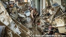 Germany Continues Evacuation And Rescue From Floods As Death Toll Rises BAD NEUENAHR, GERMANY - JULY 18: Volunteers and residents start the clean up process at their shops and restaurants following severe flash flooding on July 18, 2021 in Bad Neuenahr-Ahrweiler, Germany. (Photo by Thomas Lohnes/Getty Images)