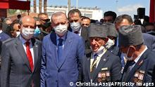 Turkish Cypriot leader Ersin Tatar (R) and Turkish President Recep Tayyip Erdogan (L) take part in a parade in the northern part of Cyprus' divided capital Nicosia, in the self-declared Turkish Republic of Northern Cyprus's on July 20, 2021. - Erdogan vowed to make no concession as he pressed for a two-state solution for Cyprus, during a visit to the divided eastern Mediterranean island. Erdogan began a two-day visit Monday to the self-declared Turkish Republic of Northern Cyprus (TRNC), whose independence is only recognised by Ankara. (Photo by Christina ASSI / AFP) (Photo by CHRISTINA ASSI/AFP via Getty Images)