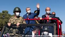 Turkish Cypriot leader Ersin Tatar (C-R) and Turkish President Recep Tayyip Erdogan (C-L) wave as they take part in a parade in the northern part of Cyprus' divided capital Nicosia, in the self-declared Turkish Republic of Northern Cyprus, on July 20, 2021. - Erdogan vowed to make no concession as he pressed for a two-state solution for Cyprus, during a visit to the divided eastern Mediterranean island. Erdogan began a two-day visit to the self-declared Turkish Republic of Northern Cyprus (TRNC), whose independence is only recognised by Ankara. (Photo by Iakovos Hatzistavrou / AFP) (Photo by IAKOVOS HATZISTAVROU/AFP via Getty Images)