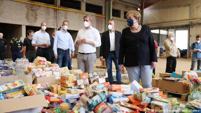Angela Merkel visits a food distribution warehouse in Bad Münstereifel