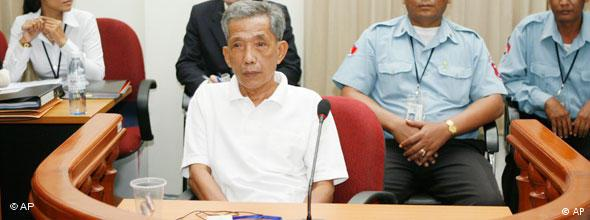 Duch looks on during a tribunal session in Phnom Penh