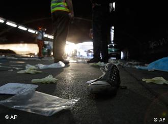 A shoe lies on the ground in a tunnel after a stampede at music festival Love Parade