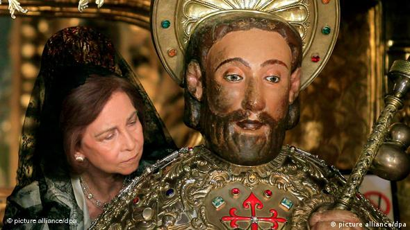 Spanish Queen Sofia gives the traditional hug to the image of Apostle Santiago at the Cathedral of Santiago de Compostela