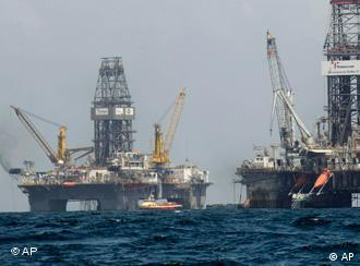 The Development Driller II, right, and Development Driller III, which are drilling the relief wells, are seen at the Deepwater Horizon oil spill site in the Gulf of Mexico, off the Louisiana coast, Thursday, July 22, 2010. (AP Photo/Gerald Herbert)