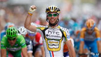 Mark Cavendish celebrates winning the final stage of the Tour de France