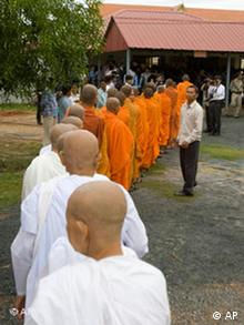 Cambodian Buddhist nuns and monks line up in front the war crimes tribunal