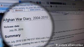 A computer screen, with a magnifying glass in front of it, highlighting the beginning of WikiLeaks' so-called 'Afghan War Diary'