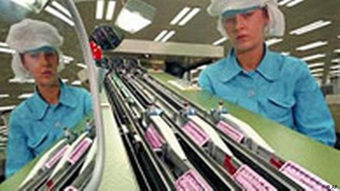 woman looking at anti-baby bill on a production line (AP)