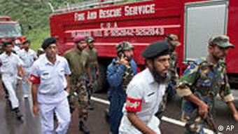 Soldiers of Pakistan Armed Forces rush to the site of a plane crash