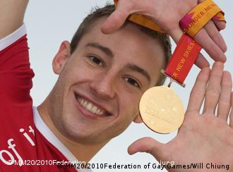 Athlete Matthew Mitcham holding a gold medal