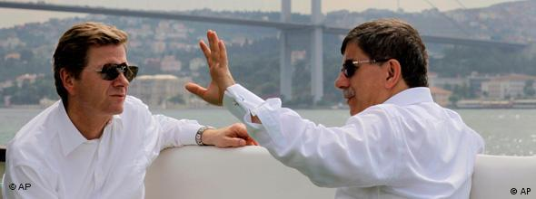 Turkey's Foreign Minister Ahmet Davutoglu, right, and his German counterpart Guido Westerwelle chat on a boat as they tour the Bosporus in Istanbul, Turkey in July, 2010