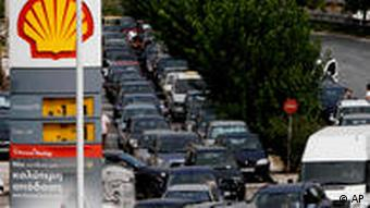 Motorists line up at a gas station, amid shortages in Athens