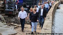 German Chancellor Angela Merkel (C-R) and North Rhine-Westphalia's State Premier, Christian Democratic Union (CDU) leader and CDU's candidate for Chancellery Armin Laschet (1stL) visit the flood-ravaged city of Iversheim, near Bad Munstereifel, North Rhine-Westphalia state, western Germany, on July 20, 2021. - The German government on July 19, 2021 pledged to improve the country's under-fire warning systems as emergency services continued to search for victims of the worst flooding in living memory, with at least 165 people confirmed dead. (Photo by WOLFGANG RATTAY / POOL / AFP) (Photo by WOLFGANG RATTAY/POOL/AFP via Getty Images)