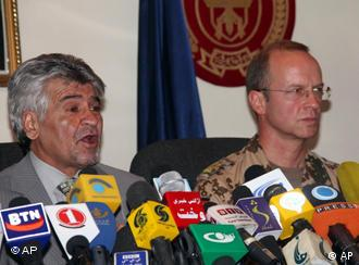 Brigadier General Josef Blotz, right, and Afghanistan's Ministry of Defense spokesman General Mohammad Zahir Azimi, left