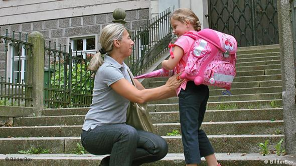 A mother with her daughter on the first day of school