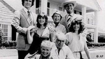 A black and white photograph of the Dallas cast