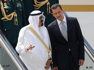 Saudi King Abdullah, left, and Syrian President Bashar Assad, right, talk to each other
