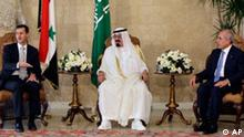 Lebanese President Michel Suleiman, right, meets with Saudi King Abdullah, center, and Syrian President Bashar Assad, left, upon their arrival at the Presidential Palace in Baabda, east of Beirut, Lebanon, Friday, July 30, 2010. The leaders of Syria and Saudi Arabia launched an unprecedented effort Friday to defuse fears of violence over upcoming indictments in the 2005 assassination of former Lebanese Prime Minister Rafik Hariri. (AP Photo/Bilal Hussein)